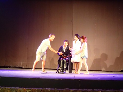 Ol gets called on stage to help with the magic trick